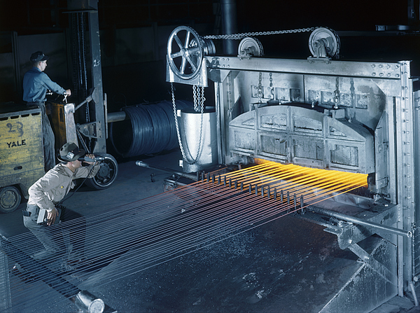 A Man Checks Temperatures Of Steel Rods Print by Willard R. Culver