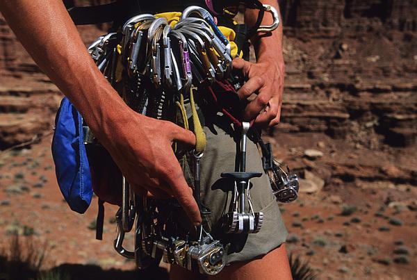 A Rock Climber Check Her Gear Print by Bill Hatcher
