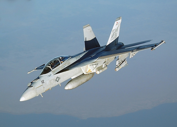 An Fa-18f Super Hornet Conducts Print by Stocktrek Images