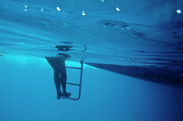 Bare Legs Descending Underwater From The Ladder Of A Boat Print by Sami Sarkis