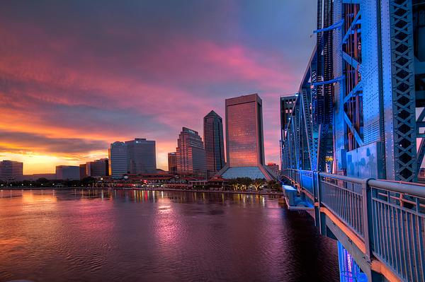 Blue Bridge Red Sky Jacksonville Skyline Print by Debra and Dave Vanderlaan
