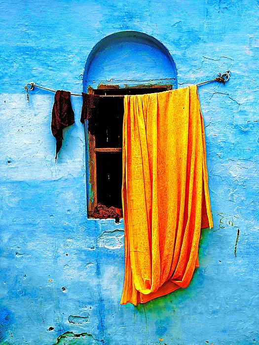 Blue Wall With Orange Sari Print by Derek Selander