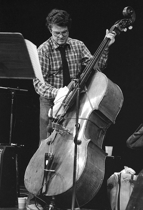 Charlie Haden Takes Care Of His Doublebass Print by Philippe Taka