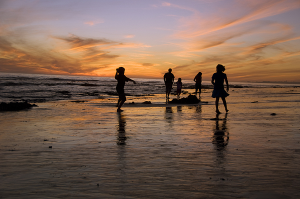 Children Playing On The Beach At Sunset Print by James Forte