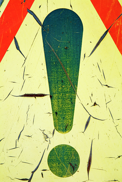 Damaged Surface Of A Road Warning Sign In France Print by Sami Sarkis