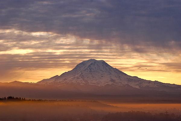 Dawn Mist About Mount Rainier Print by Sean Griffin