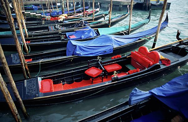 Empty Gondolas Floating On Narrow Canal Print by Sami Sarkis