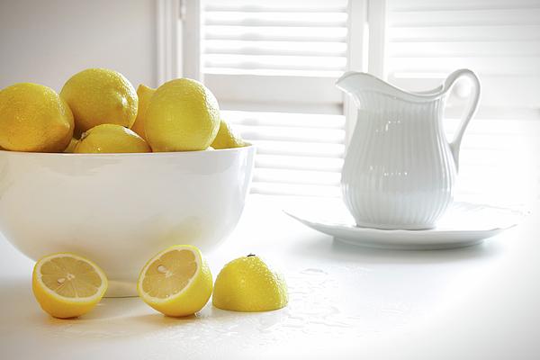 Lemons In Large Bowl On Table Print by Sandra Cunningham