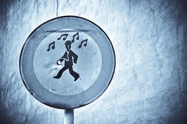 Musicman Walking Print by Keith Sanders