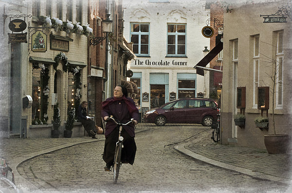 Nun On A Bicycle In Bruges Print by Joan Carroll
