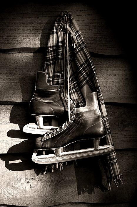 Old Hockey Skates With Scarf Hanging On A Wall Print by Sandra Cunningham