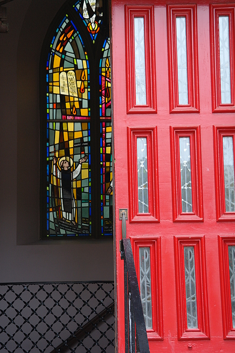 Red Door At Church In Front Of Stained Glass Print by David Bearden
