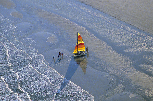 Sailors Take To The Ocean While Print by Kenneth Garrett