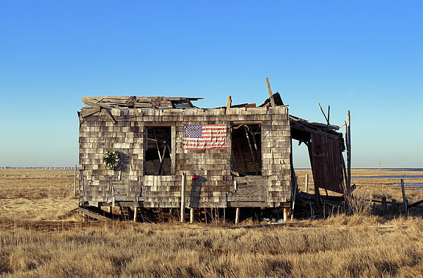 Shack With American Flag Print by John Greim