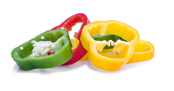 Sliced Colorful Peppers Print by Meirion Matthias
