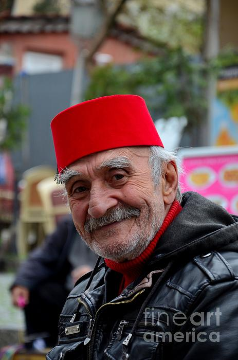 Imran Ahmed - Smiling happy old Turkish senior man in fez and leather jacket