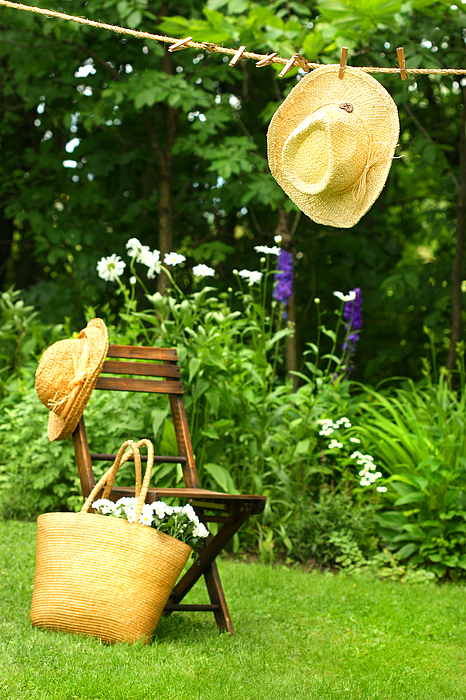 Straw Hat Hanging On Clothesline Print by Sandra Cunningham