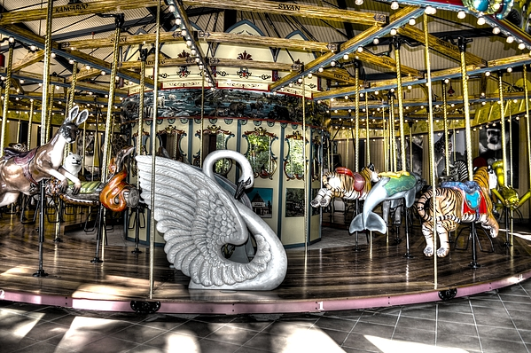 Swan Seat At The Carousel  Print by Michael Garyet
