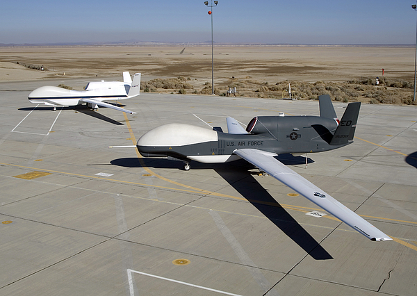 Two Global Hawks Parked On A Ramp Print by Stocktrek Images