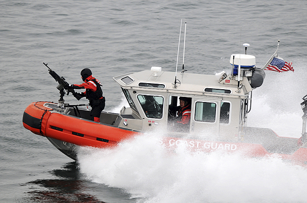 U.s. Coast Guardsmen Aboard A Security Print by Stocktrek Images