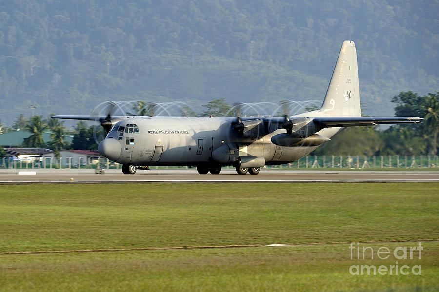 Horizontal Photograph - A C-130j Hercules Of The Royal by Remo Guidi