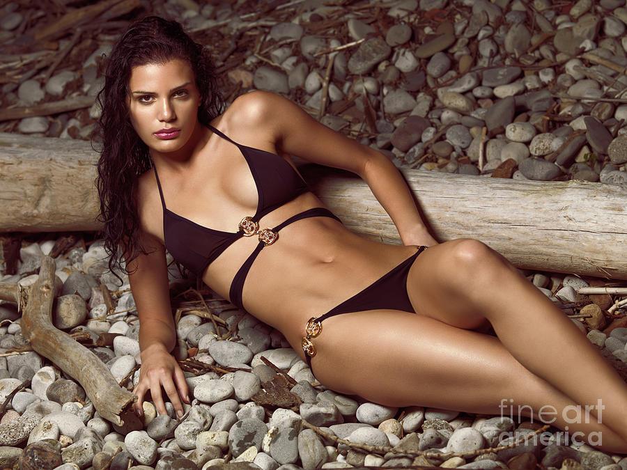 Bikini Photograph - Beautiful Young Woman In Black Bikini On A Pebble Beach by Oleksiy Maksymenko