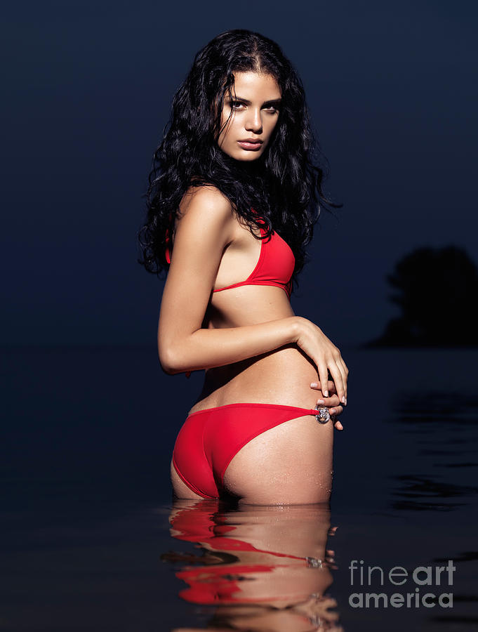 Beautiful Young Woman In Red Swimsuit Standing In Water Photograph