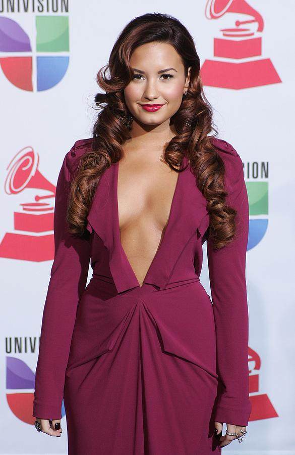 Demi Lovato Photograph - Demi Lovato Wearing A Roland Mouret by Everett