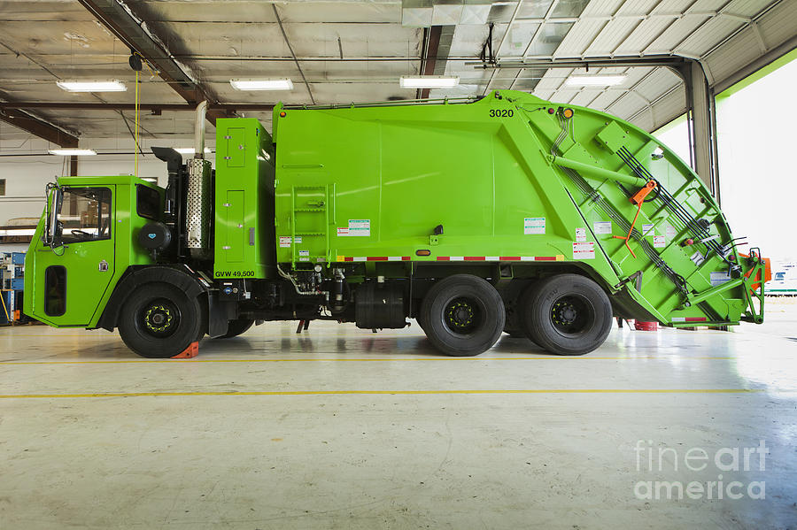 Bay Door Photograph - Green Garbage Truck Maintenance by Don Mason
