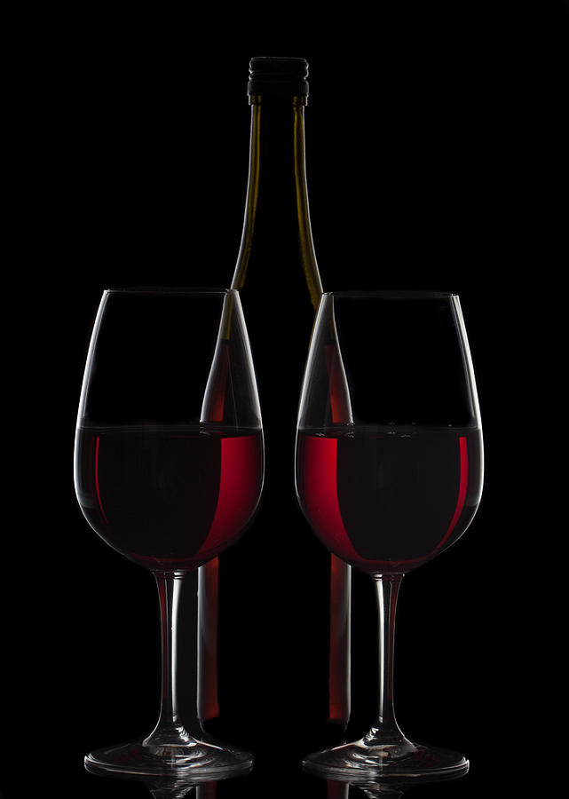 Red wine bottle and two wine glasses on black background for Red glass wine bottles suppliers