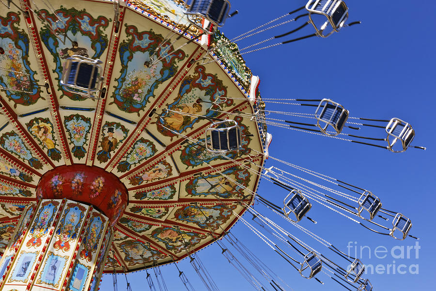 Blue Sky Photograph - Swing Ride At The Fair by Jeremy Woodhouse