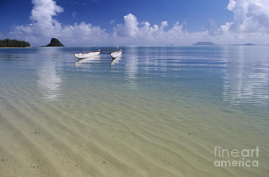 Aku Photograph - White Double Hull Canoe by Joss - Printscapes