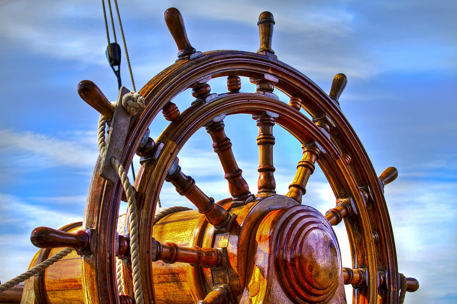 Boats Photograph - The Helm by Debra and Dave Vanderlaan