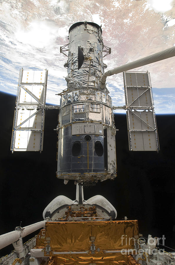 Releasing Photograph - The Hubble Space Telescope Is Released by Stocktrek Images