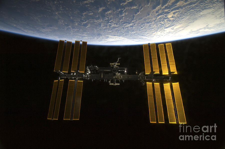 Sts-130 Photograph - International Space Station by Stocktrek Images