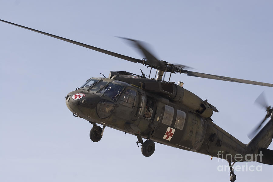 Aviation Photograph - A Uh-60 Blackhawk Medivac Helicopter by Terry Moore