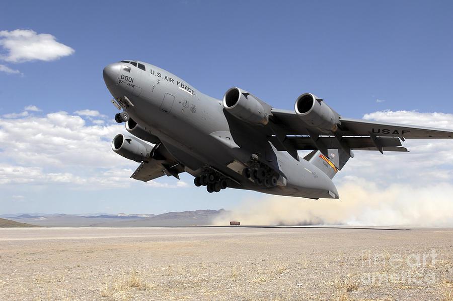 Nevada Photograph - A C-17 Globemaster Departs by Stocktrek Images