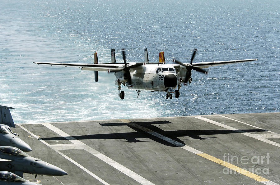 Aircraft Photograph - A C-2a Greyhound Prepares To Land by Stocktrek Images