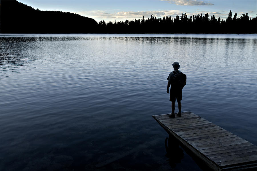 One Person Photograph - A Man Looking Across A Lake. Into by Dawn Kish