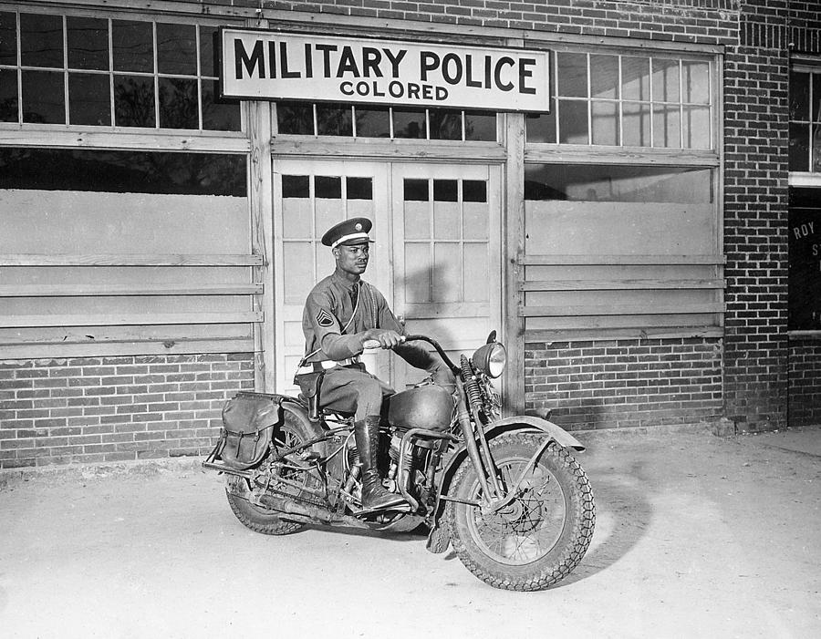 1950s Candids Photograph - A Military Police Officer Posed by Everett