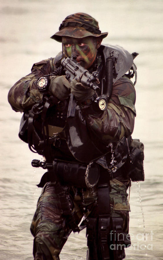 Military Photograph - A Navy Seal Exits The Water Armed by Michael Wood