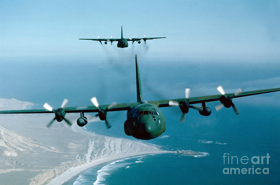 Horizontal Photograph - A Pair Of C-130 Hercules In Flight by Stocktrek Images