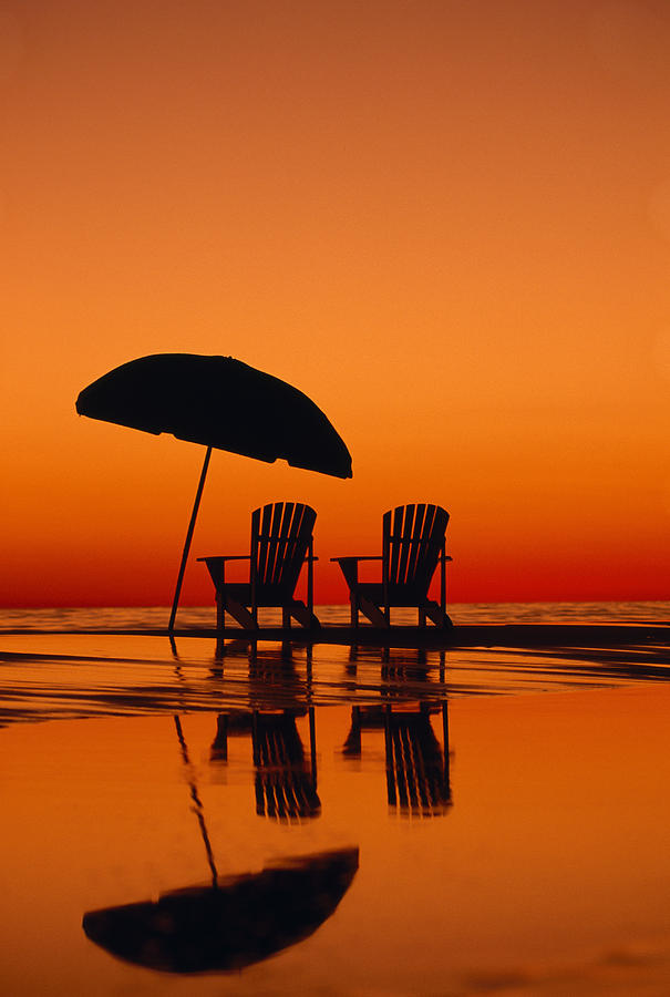 Seaside Photograph - A Picturesque Scene With Two Chairs by Michael Melford