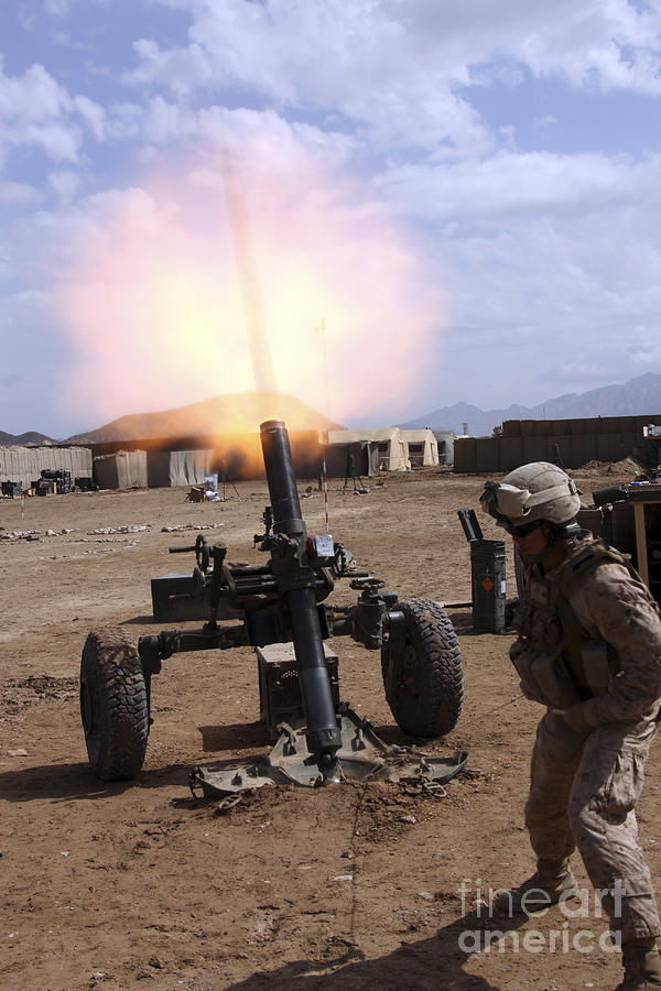 Us Marine Corps Photograph - A U.s. Marine Corps Gunner Fires by Stocktrek Images