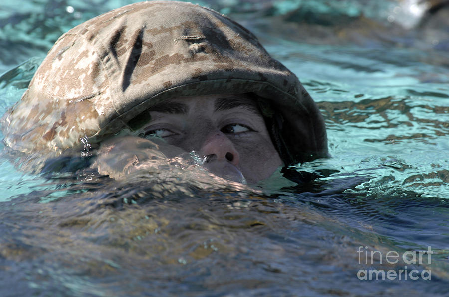 A U.s. Marine Swims Across A Training Photograph