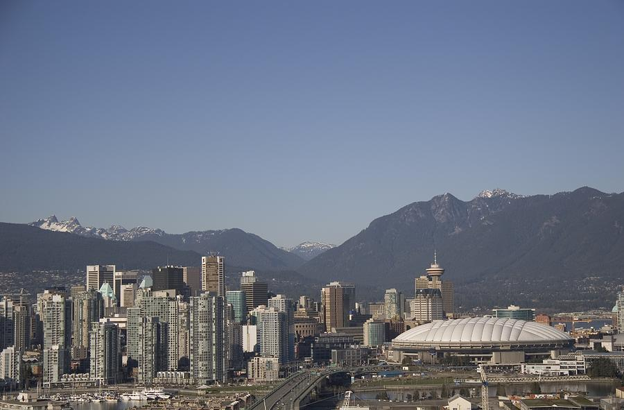 Scenes And Views Photograph - A View Of The Skyline Of Vancouver, Bc by Taylor S. Kennedy