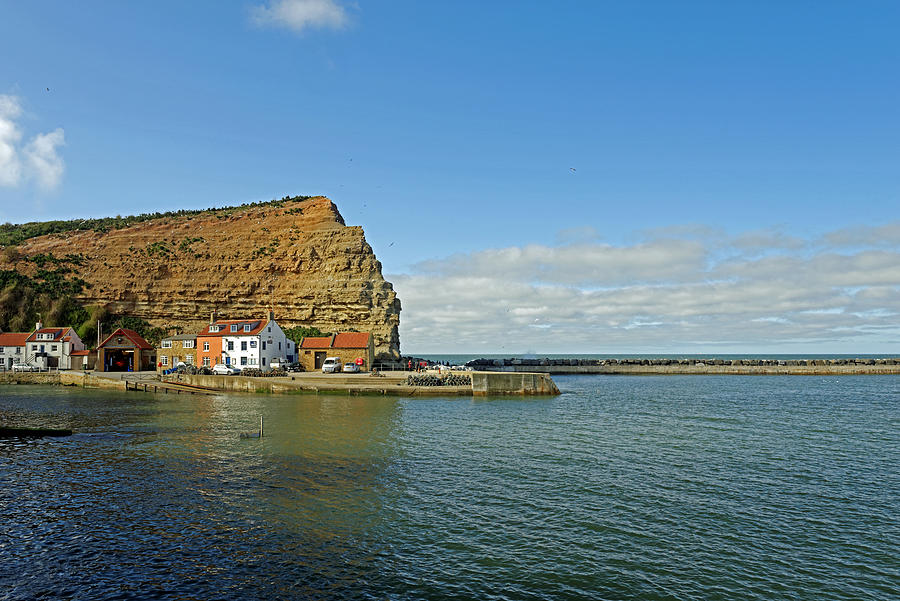 Across Staithes Harbour To Cowbar Nab Photograph