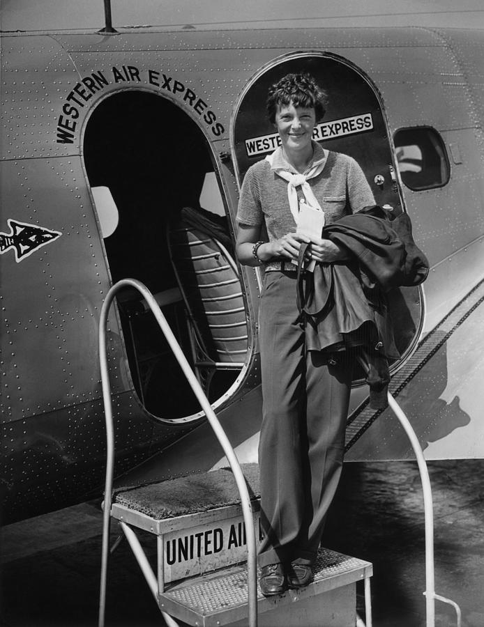 History Photograph - Amelia Earhart 1897-1937 Standing by Everett