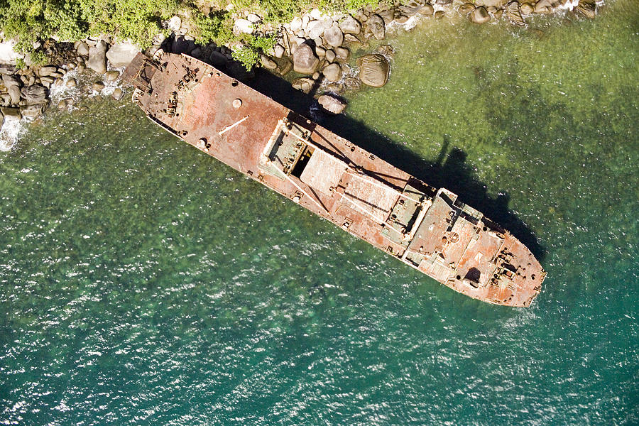 Africa Photograph - An Abandoned Cargo Ship On Nosy Mangabe by Michael Fay