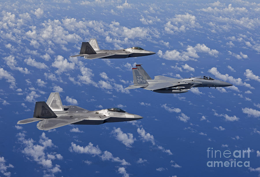 An F-15 Eagle And Two F-22 Raptors Fly Photograph
